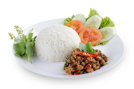 Authentic Thai fried chicken with basil with rice isolated on white background. Authentic Thai basil chicken recipe