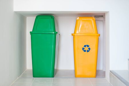 Colorful recycle bins on the floor. Waste disposal in apartment buildings