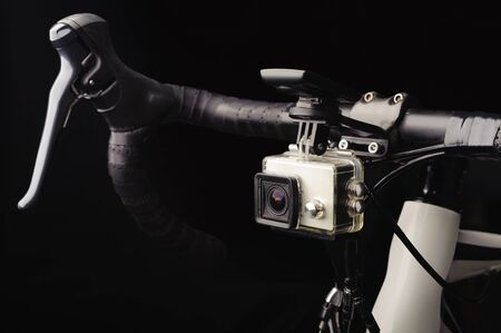Bicycle with front action camera on black background 写真素材