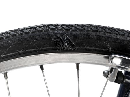 Close up of worn out bicycle tyre isolated on white background. Bicycle tire sidewall damage