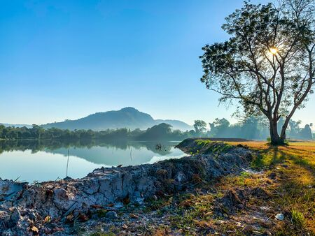 Natural landscape of clear blue sly, lake and mountain at sunrise 写真素材