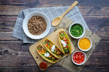 Hard shell Beef Taco with ingredients. Maxican tacos with grounded beef