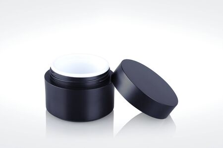 Black shiny cosmetic jar isolated on background