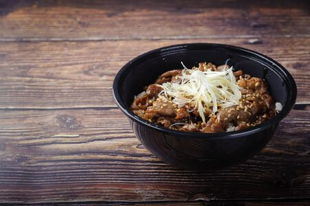 Buta-don, authentic Japanese cuisine. Pork rice bowl on wooden background