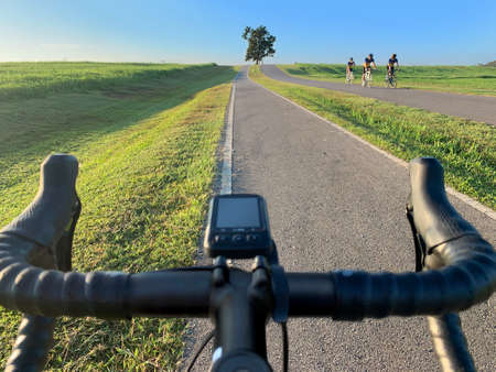 Beautiful scenery landscape passing by with group of cyclists on the bike lane in public park- exercise and healthy lifestyle concept Standard-Bild