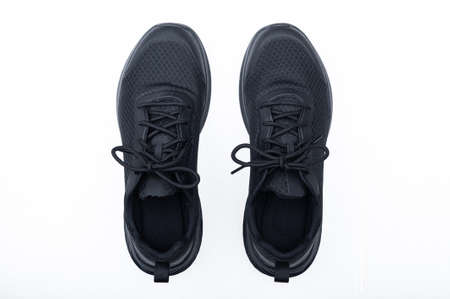 Black sport shoes isolated on white background. Closeup