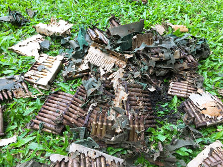 Damaged M16 assault rifle ammunitions and cardboard box eaten by termite