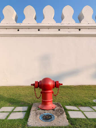 Typical red fire hydrant on sidewalk of Bangkok, Thailand Imagens