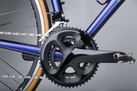 Detail of bicycle components. Closeup of crankset, front derailleur and chains Imagens