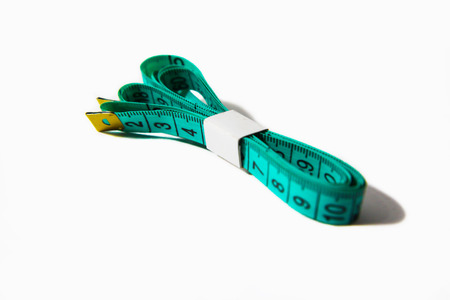 centimetre: Green tape measure on white background Stock Photo