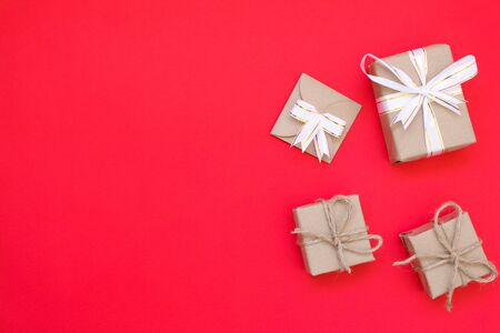Brown gift box on red background