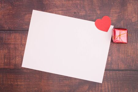 Paper heart with empty boxes and paper on wooden floors, Valentines Day - images