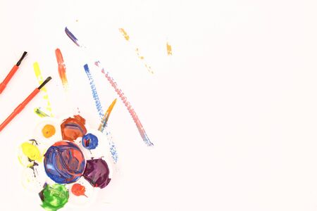 Watercolors and brushes and color stains on a white background Lay flat, top view - image Stock Photo