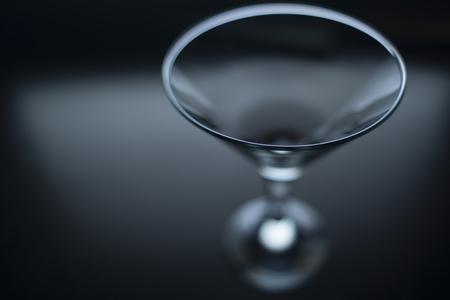 cocktail glasses: a martini glass at the dark tone