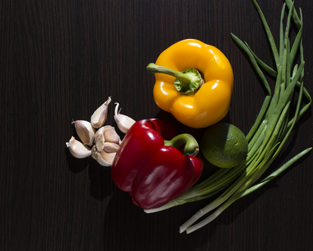 nutricion: a vegetables on a dark wooden table