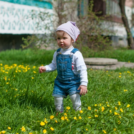 cuteness: one year-old girl in a denim suit