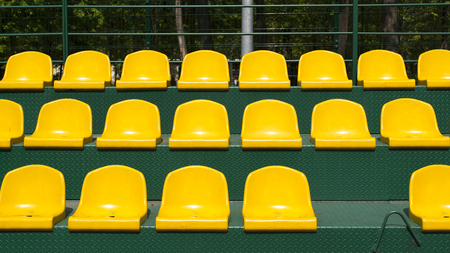 tribune: a yellow seats on the green tribune