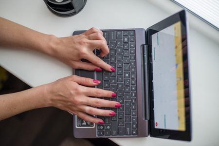 ultrabook: Female hands working on ultrabook on the windowsill Stock Photo