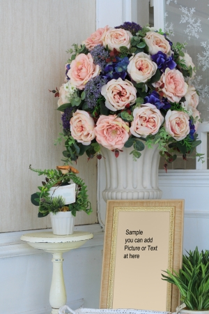 Vintage room with a large vase of roses  photo