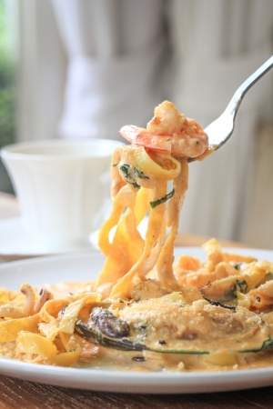 Fresh linguine with king prawns, mussels and a chilli and herb sauce  photo