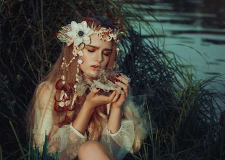 small -eared fairy sits surrounded by fantastic fairy lilies on the lake,