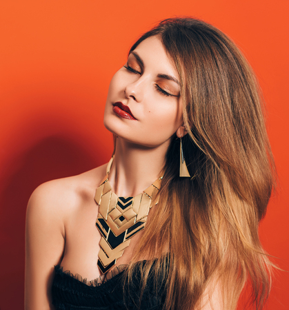 color model: beautiful girl with a spectacular make-up and necklace in boho style , beauty portrait, fashionable toning , creative color Stock Photo