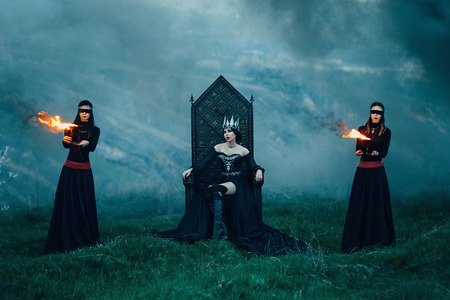 sirvientes: dark evil queen sneaks through the stone canyon, fire lady sitting on a black gothic throne surrounded by servants, wild Princess, vampire, thigh toning, creative color, dark-Boho