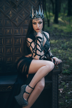 dark evil queen sitting on a luxurious throne, wild Princess , vampire , hip toning , creative color,dark boho