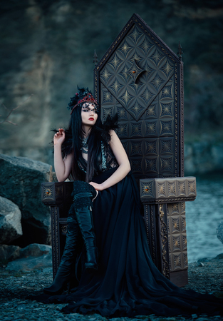blackness: dark evil queen sitting on a luxurious throne, dark boho, cosplay to the film SNOW WHITE AND THE HUNTSMAN, wild Princess, vampire, hip toning, creative color