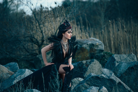 blackness: dark evil queen sneaks through the stone canyon at cosplay movie snow white and the Huntsman wild Princess, vampire, hip toning, creative color, dark boho