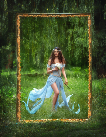 The picture is fantastic lady, luxurious, fancy dress. Mysterious Flirty fairy walks in the woods. Mythical white flower in his hands. Lovely long legs. Beautiful hair accessory handmade. Picturesque landscapes of the outdoors.Toning fashion. Creative col