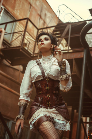 bodice: Portrait of a girl in a steampunk style. She is dressed in cool, unusual clothes. Creative colors
