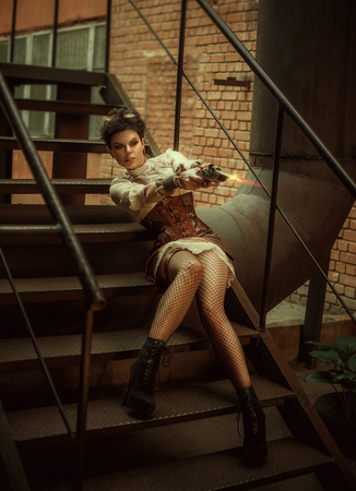 bodice: Portrait of a girl in a steampunk style. She is dressed in cool, unusual clothes. The photo shows shooting from an old gun. Creative colors