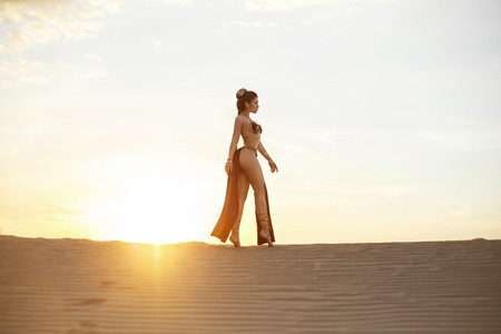Cosplay Leia Organa Solo. A beautiful, girl walks in the desert. Creative colors
