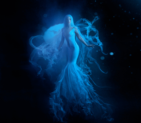 A white mermaid, with very long and blue hair floating under the water. An unusual image, the tail of a jellyfish. Levitation and weightlessness. Pale skin, gentle makeup. Art photo 写真素材
