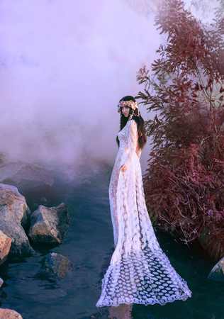 Incredible nymph, walks in the water in the middle of the river which was tightened by a thick, impenetrable fog. There is a white vintage dress on the mermaid. Feast of Ivan Kupala