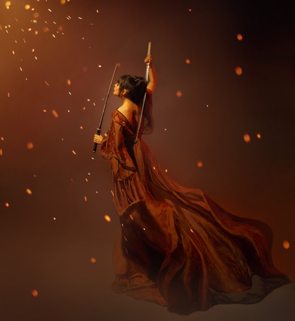 young kunoichi girl samurai in a long dress with a lotus tattoo on the back, holding katana in hands. the child of war, princess becomes a warrior. art photo in orange and brown colors, glare, sparks. Banco de Imagens