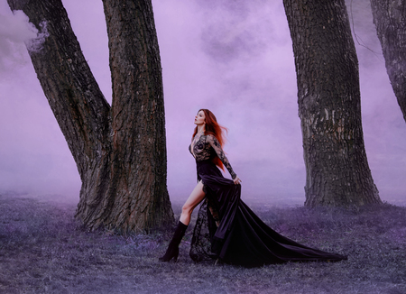 Seductive vampire defiantly goes baring beautiful long legs. Ginger witch in a black silk dress with a long train, runs in the purple fog, hair fluttering in the wind. Countess Dracula. Art processing