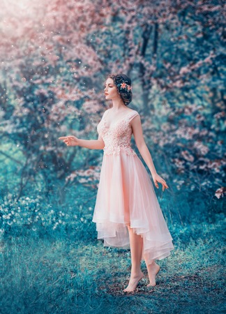 pretty slender girl with braided dark hair in a delicate elegant peach dress, a fairy-tale princess in a frozen flowering forest, a gentle image of the forest queen, fairy in love, creative colors