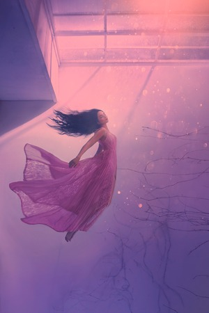 mysterious sleeping girl with long flowing black hair, levitating beauty in long flying pink tender dress, sinking lady in red light goes to bottom and algae, sea jellyfish in human form, water nymph Stock Photo