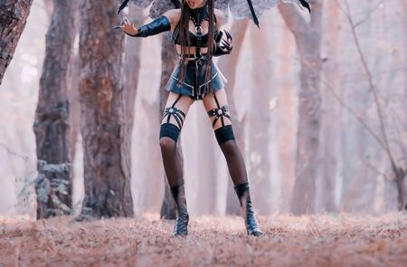 dark mistress in seductive costume in jump, aggressive demoness in short leather latex skirt and belts, copronic stockings on succubus with long remaining claws, mythical creature without face
