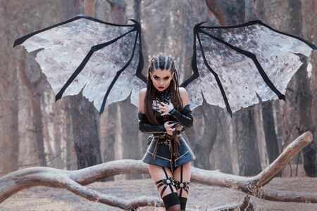 female demon with and dark makeup, girl with big wings in black short leather latex skirt and straps on legs, bloody vampire preparing to attack victim, demon of passion and takes innocent souls