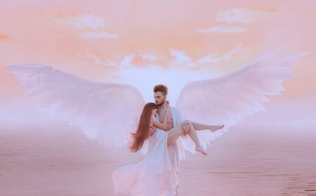 Strong muscular male angel holds hug fragile innocent woman in arms. concept protection prayer security helper keeper love faith help religion. Fine art imagery sky. Girl and handsome man embracing
