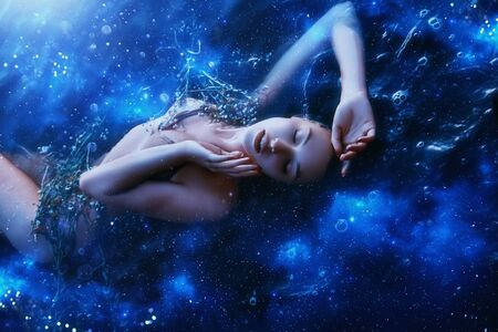 Artistic processing. young relax Sleep dream Beauty. Concept sexy sky woman cosmos harmony energy star radiance flat. image goddess world nature resting one girl. Bright color black blue glitter shine