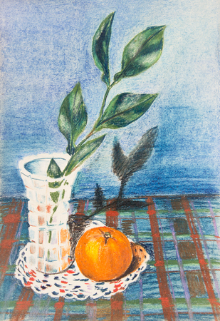 Crystal vase with a branch of citrus tree. Orange is on the table.