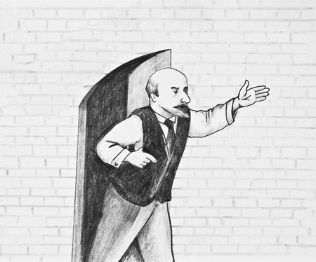 The man stands near the open door and points into the distance