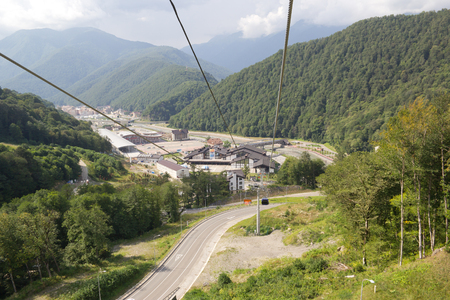 ROSA KHUTOR, RUSSIA - AUGUST 11, 2014: Railway station Rosa Khutor ski resort Alpika Service. The view from the top.