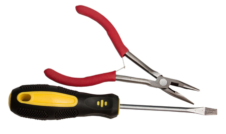 Pliers and screwdriver isolated on white background
