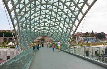 Tbilisi, Georgia - August 9, 2013: The Bridge of Peace . The bridge stretches over the Kura river and connects the areas of old city.