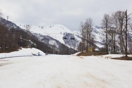 Krasnaya Polyana, Russia-April 17, 2015: Ski track and cable car
